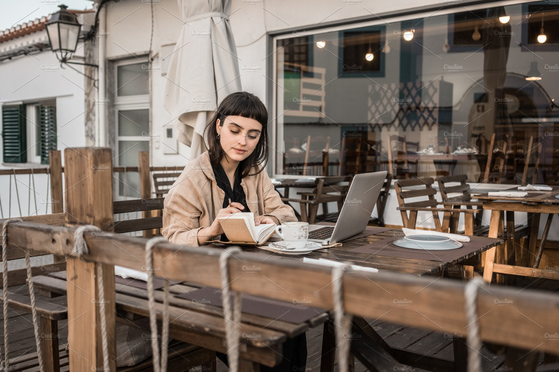 Woman in cafe with laptop
